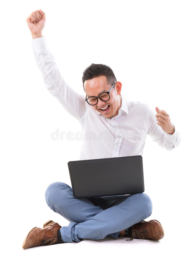 Download Excited Asian Man Using Laptop Stock Photography - Image: 32465102