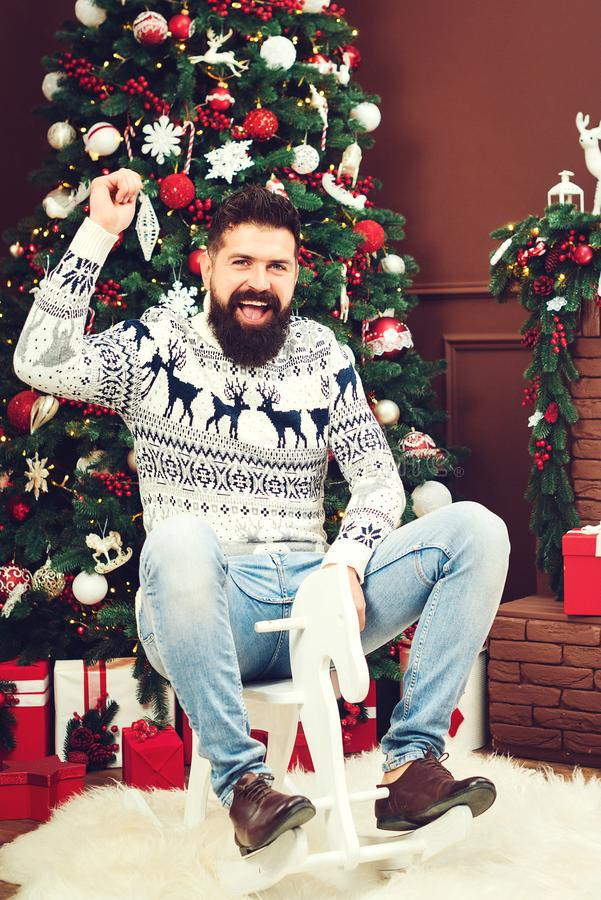 Excited bearded guy having fun at christmas party. Happy New Year. Winter fashion and sales stock photo