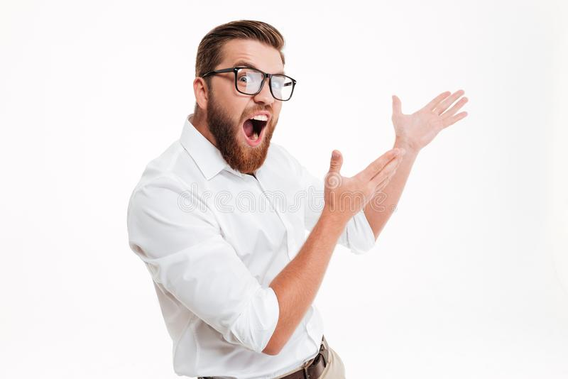 Excited bearded man in eyeglasses pointing away at copy space royalty free stock photos