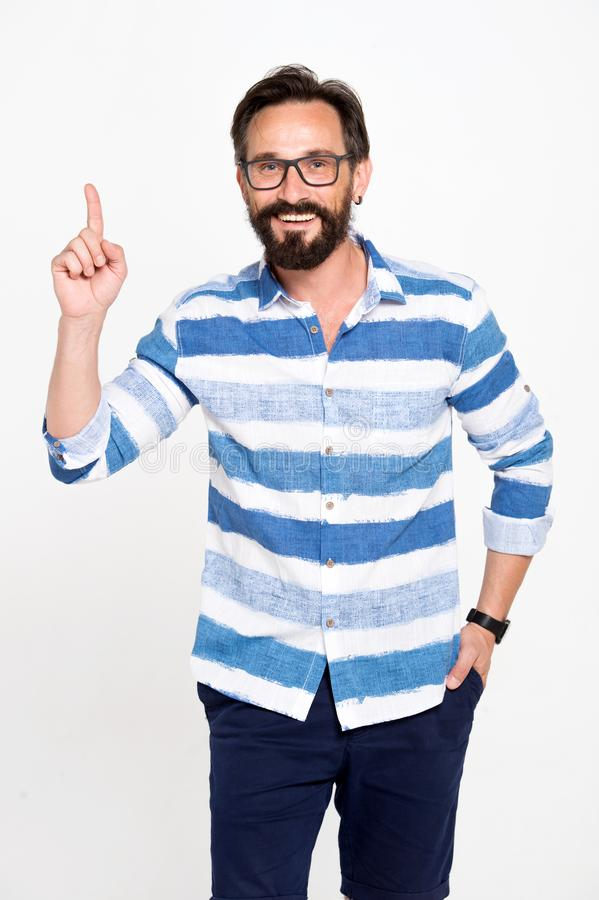 Excited bearded man with glasses holding forefinger up and looking enlightened with brilliant idea. Man points up to info. Rmation on white background stock photo