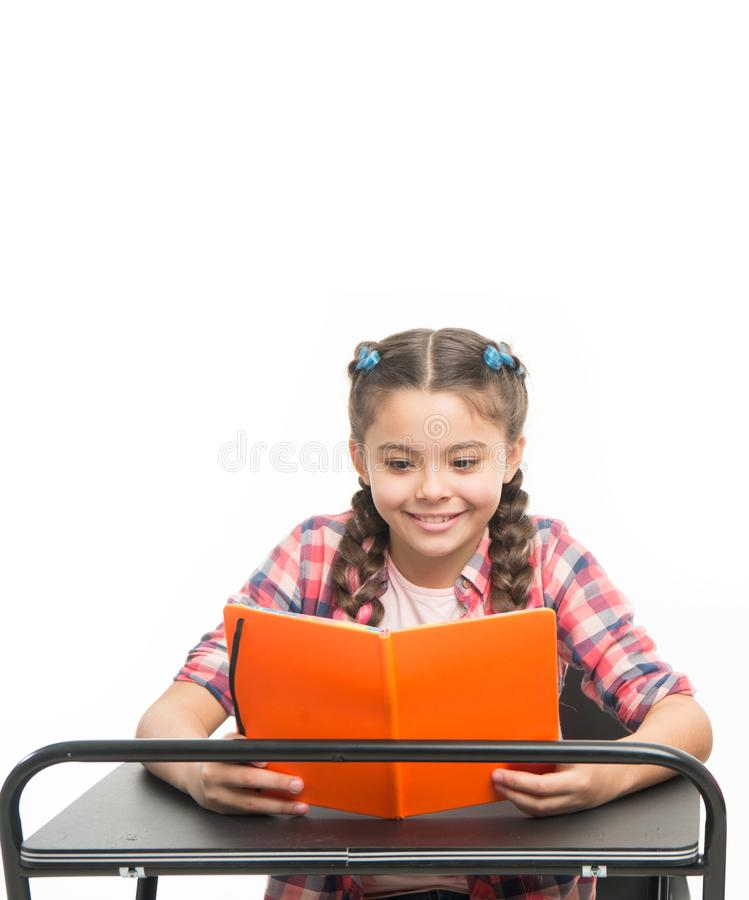 Excited about book ending. Personal attitude determines success. Acquiring knowledge. Small girl with book sit at desk. Reading lesson. Little child learn royalty free stock photos