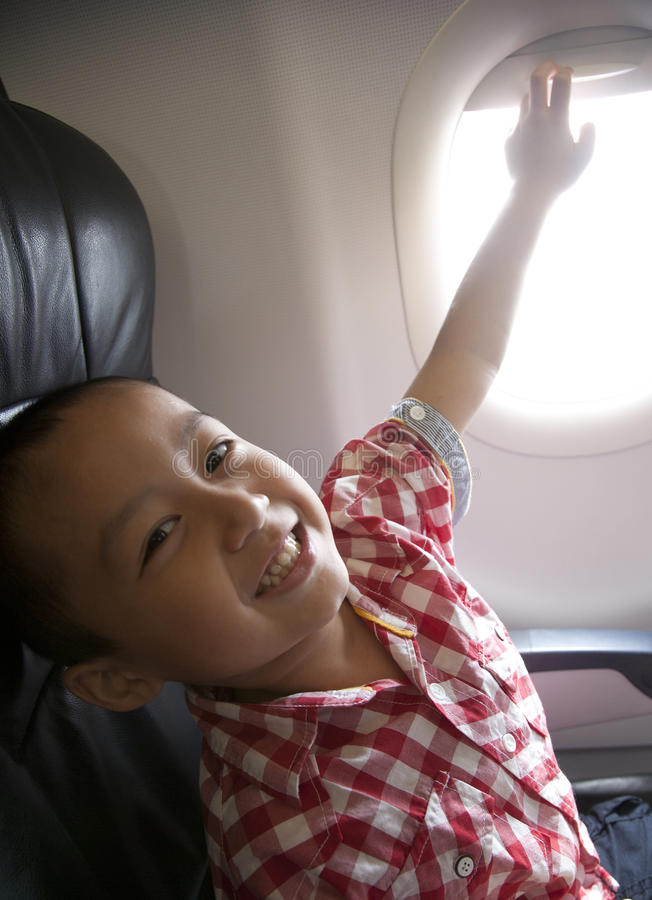 Excited boy in an airplane stock image