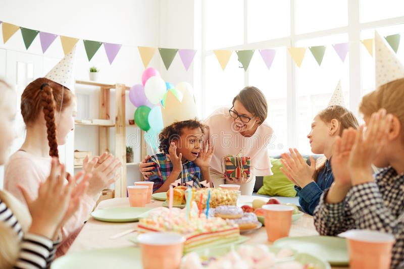 Excited Boy at Birthday Party stock images