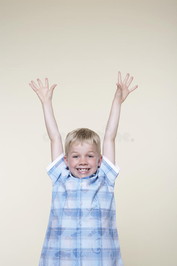 Download Excited Boy With Hands Raised Stock Image - Image: 29657453