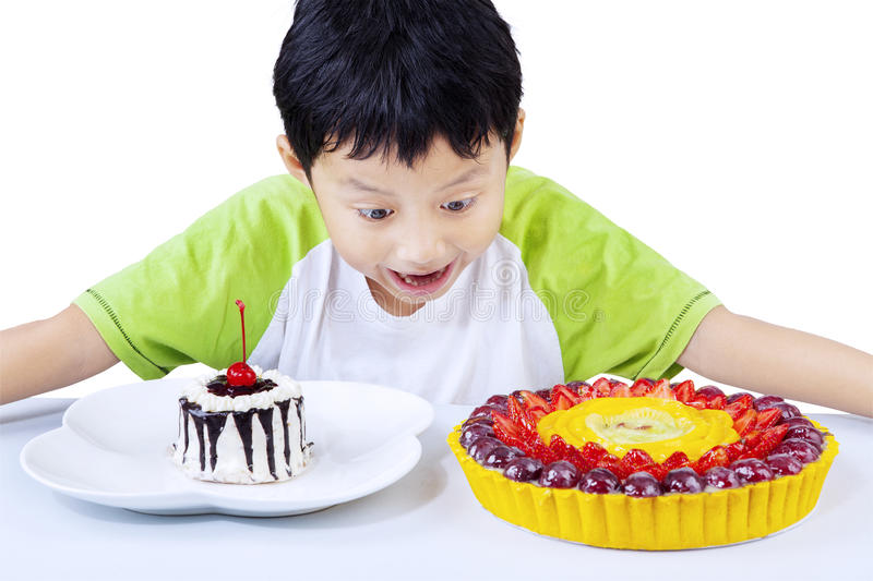 Download Excited Boy Looking At Colorful Desserts Stock Image - Image of happy, cake: 30745677
