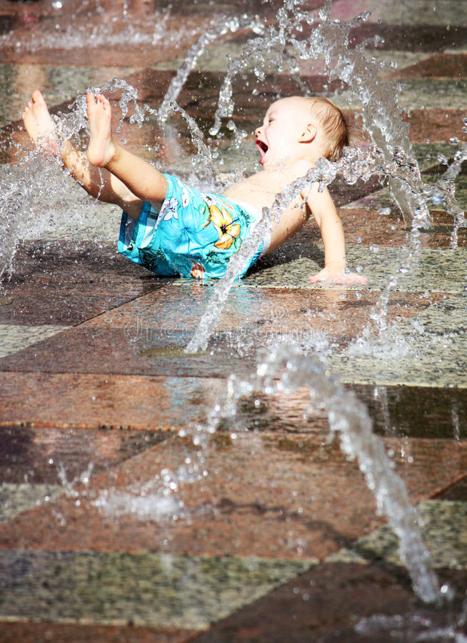 Excited Boy Playing in Splash Pad royalty free stock photos