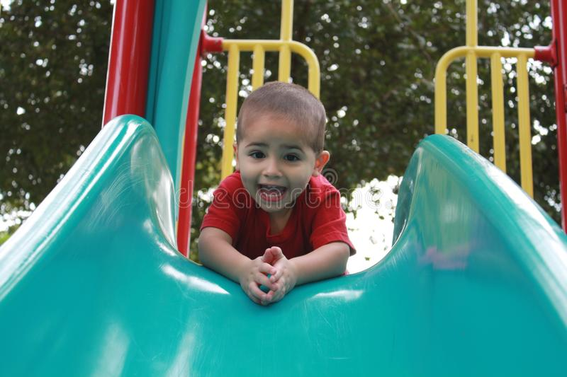 Download Excited boy on slide stock photo. Image of enjoyment - 12350210
