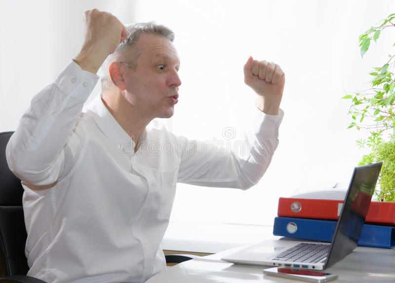 Excited business looking at laptop. stock images