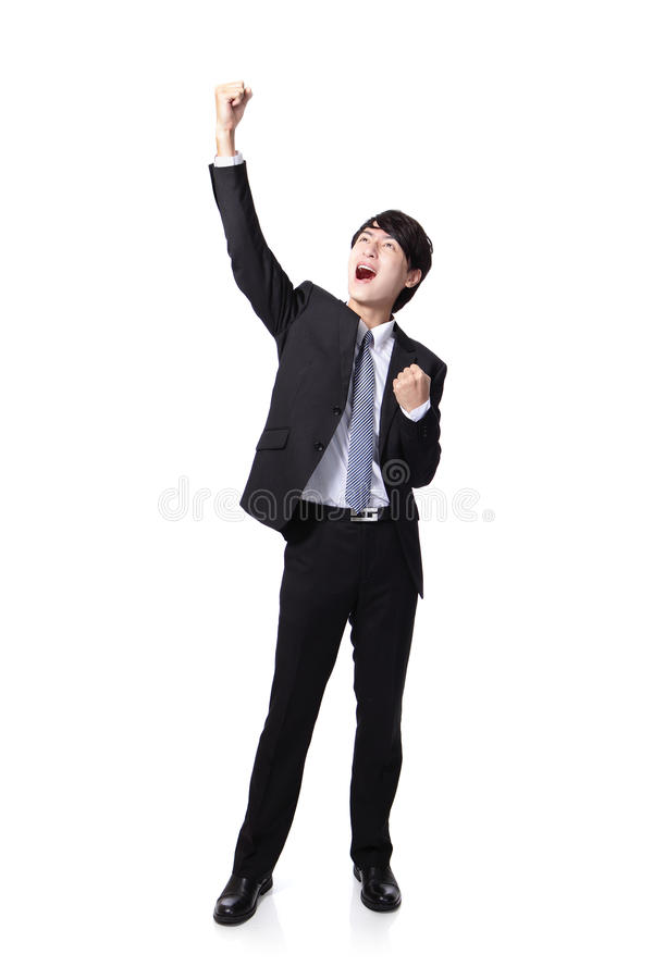 Excited business man with arms raised. Excited handsome business man with arms raised in success in full length Isolated on white background, mode is a asian royalty free stock photography