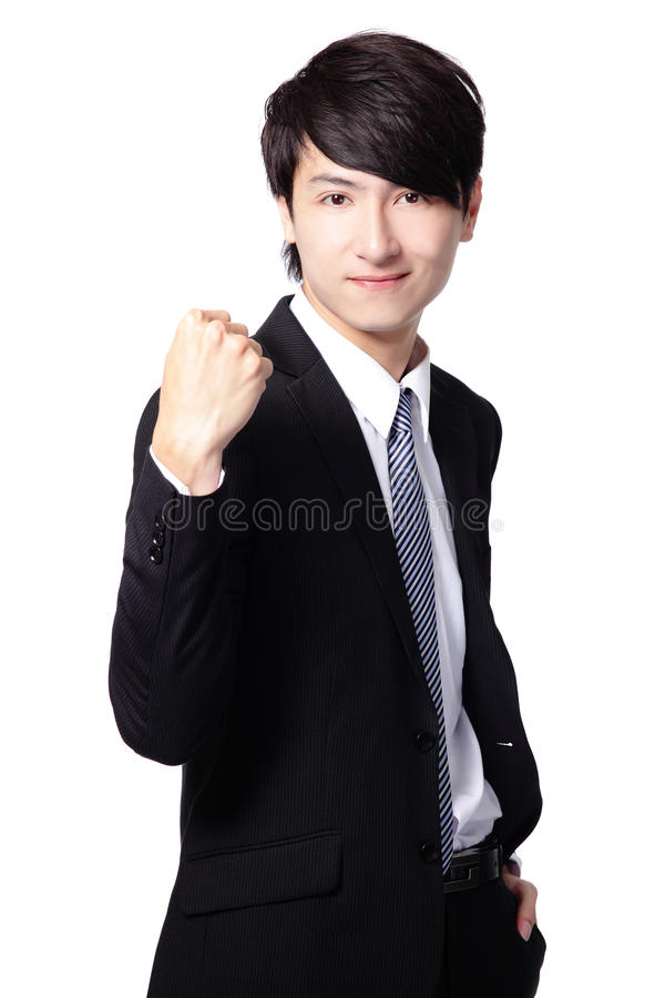 Excited business man showing his fist