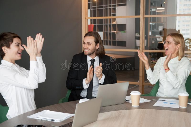 Excited business team applauding congratulating partner with suc stock images