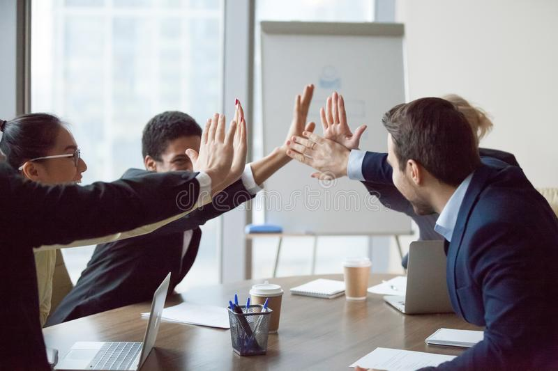 Excited business team give high five celebrate corporate success. Excited business team give high five, happy employees partners businesspeople group celebrate royalty free stock photo