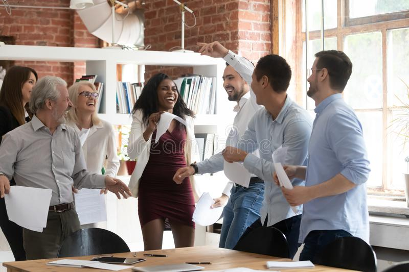 Excited business team people dancing holding papers celebrate successful contract stock image