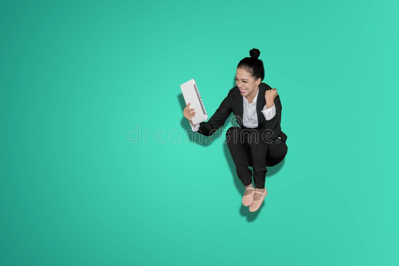 Excited business woman celebrating success stock photo