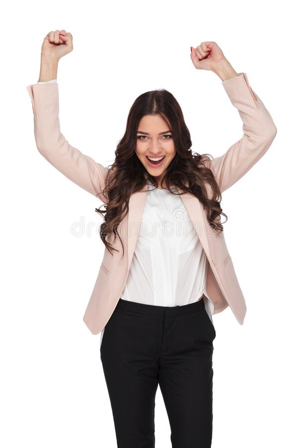 Excited business woman with hands in the air screaming stock photos