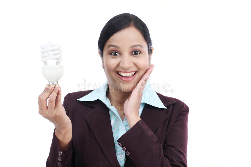 Excited business woman holding bulb stock photography