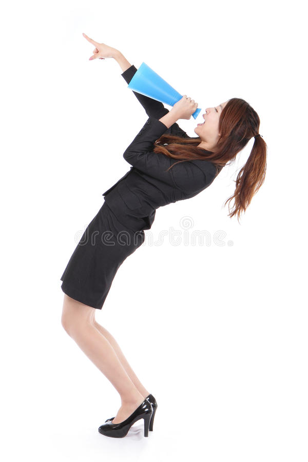 Excited business woman yelling through megaphone stock images
