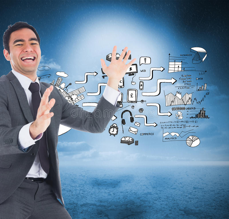 Excited businessman catching. Composite image of excited businessman catching stock images