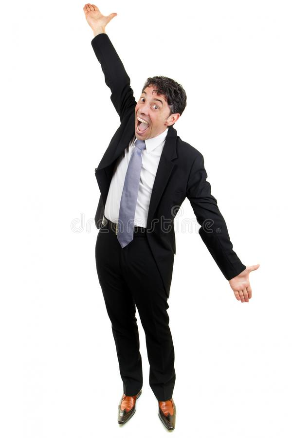 Excited businessman cheering. Excited middle-aged businessman in a suit celebrating an achievement or success cheering and raising his arms in the air in royalty free stock photo