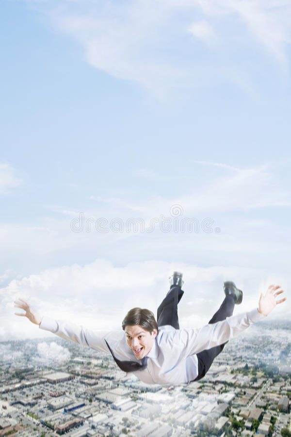Excited Businessman Flying In The Clouds royalty free stock photo