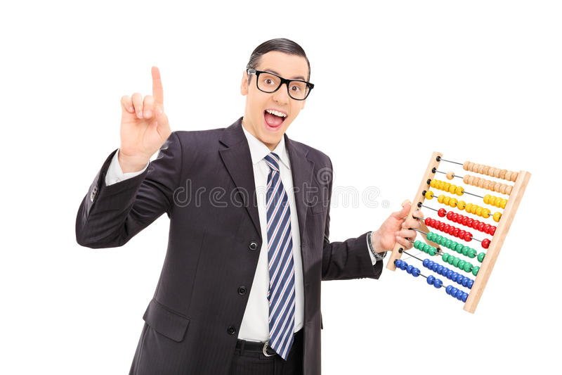 Excited Businessman Holding An Abacus Stock Photo