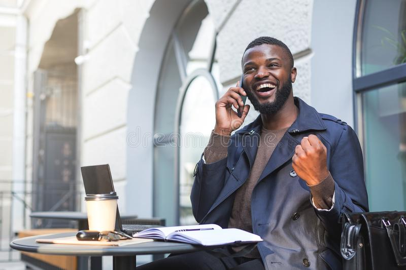 Excited businessman just landed a deal with a company over the phone stock photography