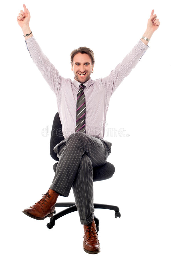 Excited businessman raising his hands stock images