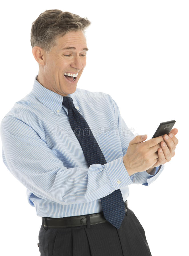 Download Excited Businessman Reading Text Message On Smart Phone Stock Image - Image: 32062057