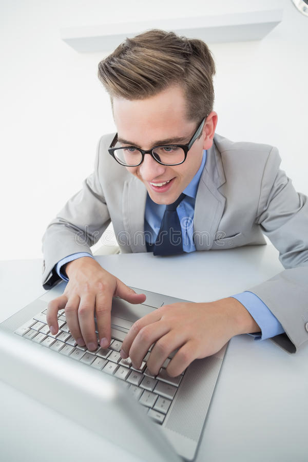 Excited businessman working on laptop stock photography