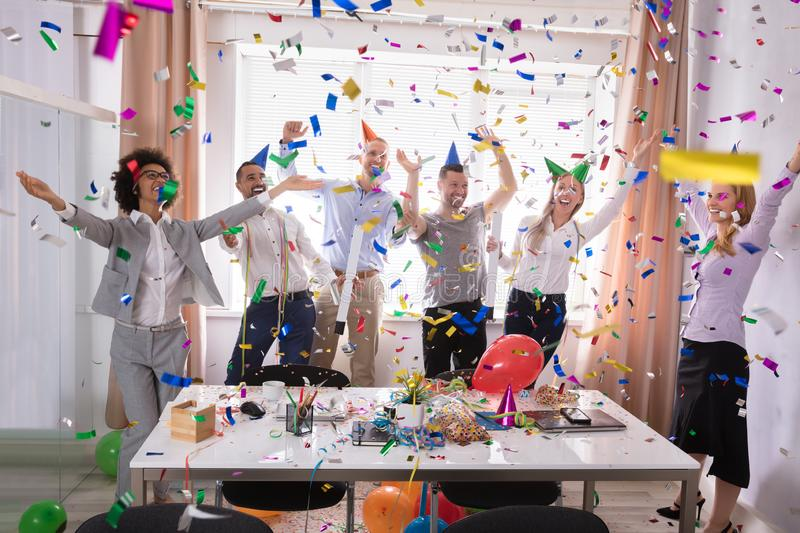 Excited Businesspeople Having Fun Raising Their Arms stock photos