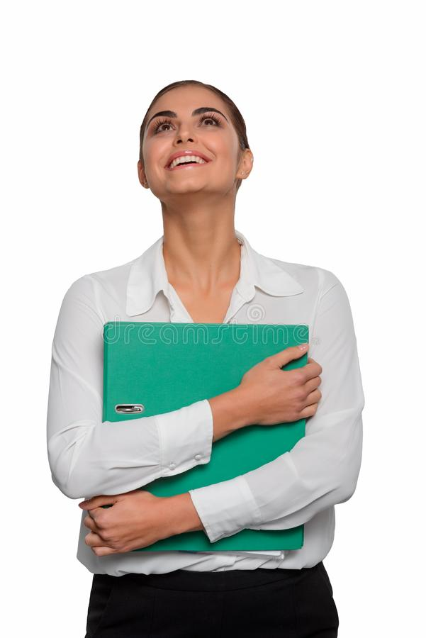 Excited businesswoman with documentation. She embraces with both hands. Beauty looks upwards with a happy face and positive emotions in the end of a hard royalty free stock photography