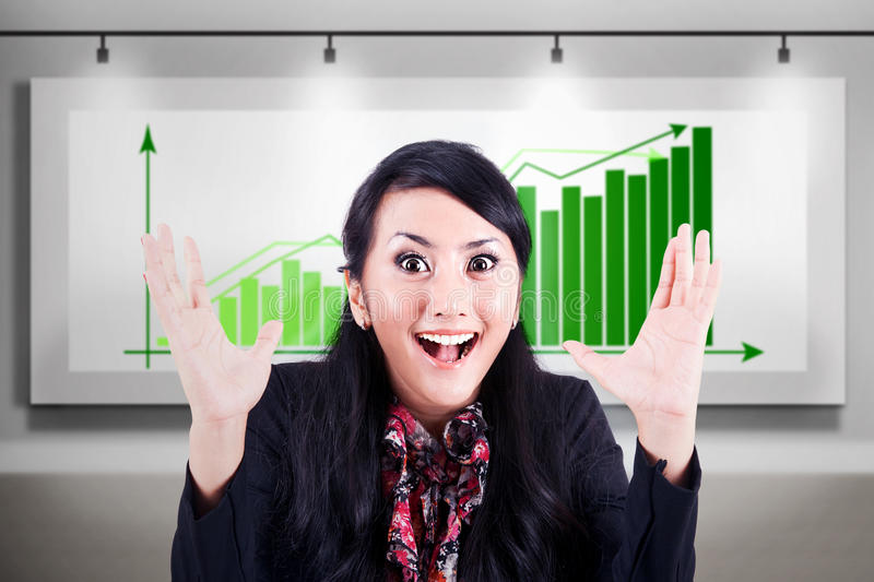 Excited businesswoman with profitable bar chart stock images