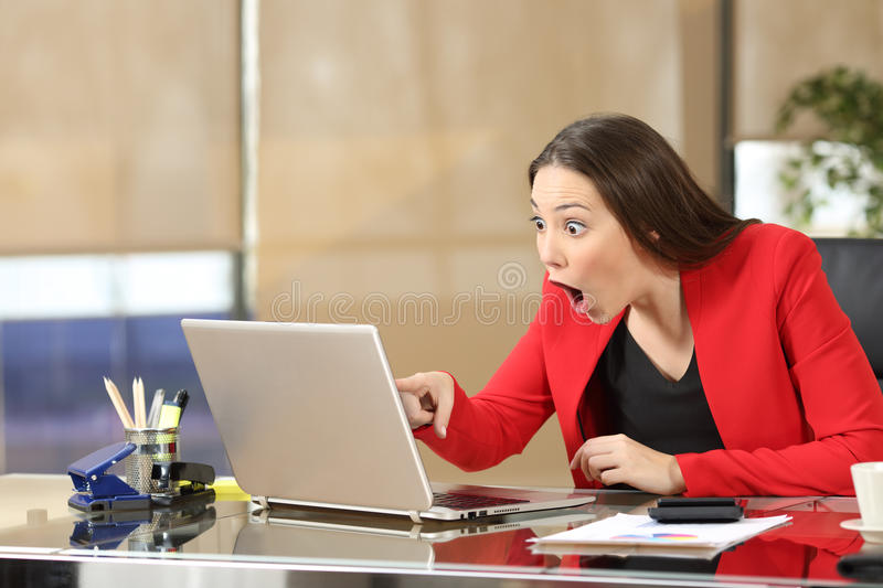 Excited businesswoman watching amazing news stock photos