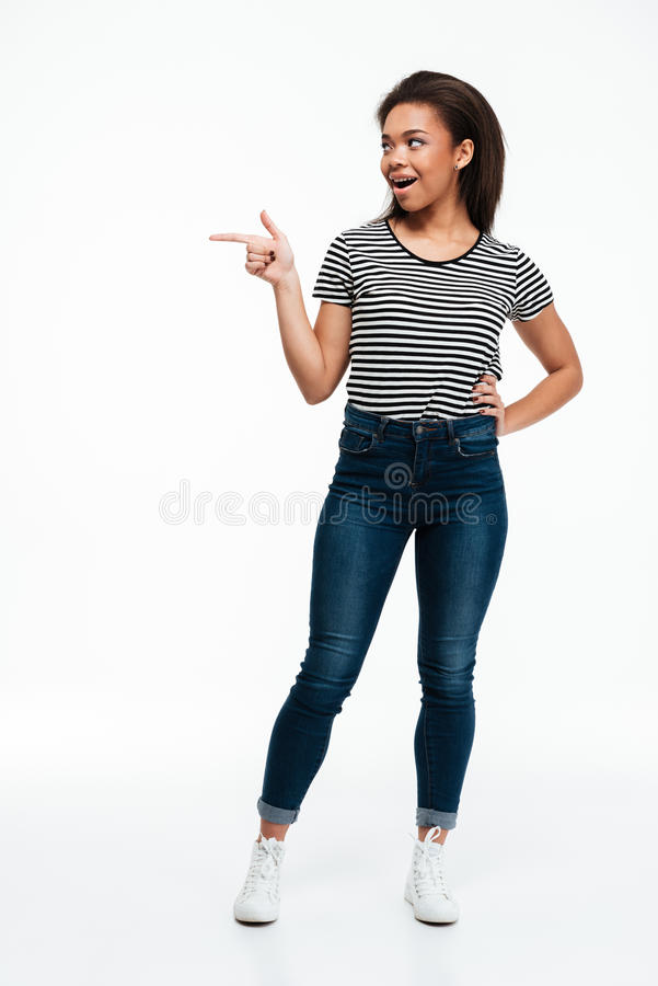 Excited casual afro american woman pointing finger away stock images