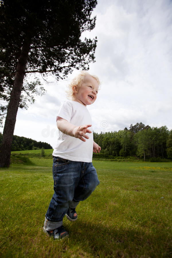 Excited Cheeful Boy Running royalty free stock images