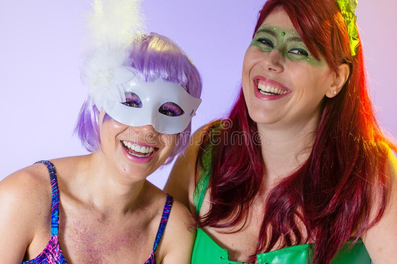 Excited and Cheerful. Face of brazilian women with violet wig and make up mask. Bright and Colorful. Holiday concept, tradition. Carnaval Brazil. Excited and stock photo