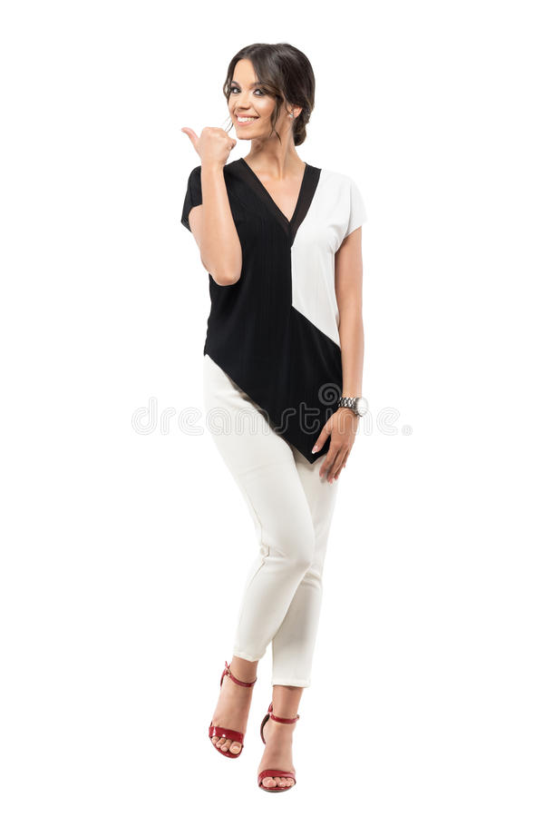 Excited cheerful pretty business woman in suit showing thumb up hand gesture. royalty free stock photos