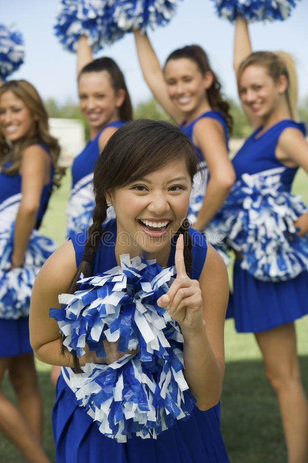 Excited Cheerleaders Cheering stock images