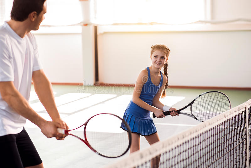 Excited child and dad having fun on tennis court royalty free stock images
