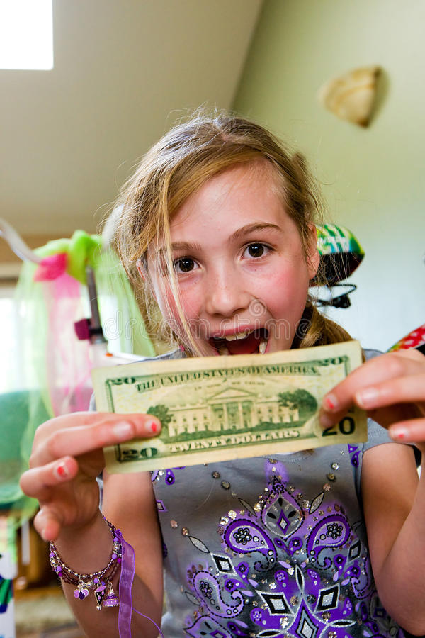 Excited Child With Money Royalty Free Stock Photos