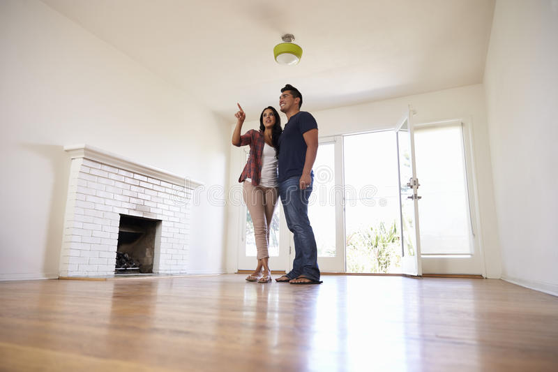 Excited Couple Explore New Home On Moving Day royalty free stock photos