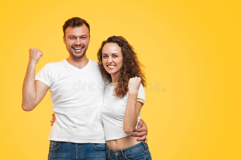 Excited couple with fists up royalty free stock photography
