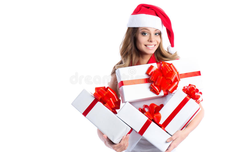 Excited cute happy young Caucasian teenage girl with gifts box and Santa hat. royalty free stock images