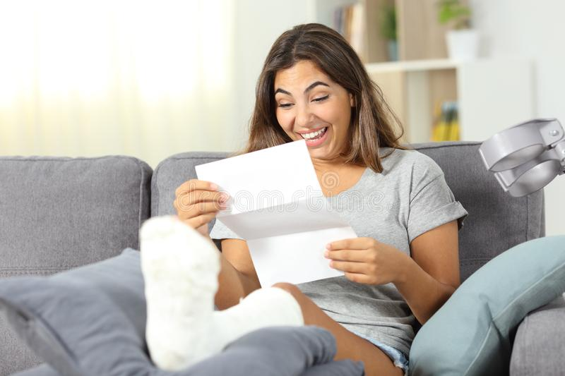 Excited disabled girl reading a paper letter at home royalty free stock images