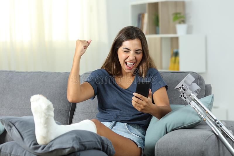Excited disabled woman receiving online news royalty free stock photos