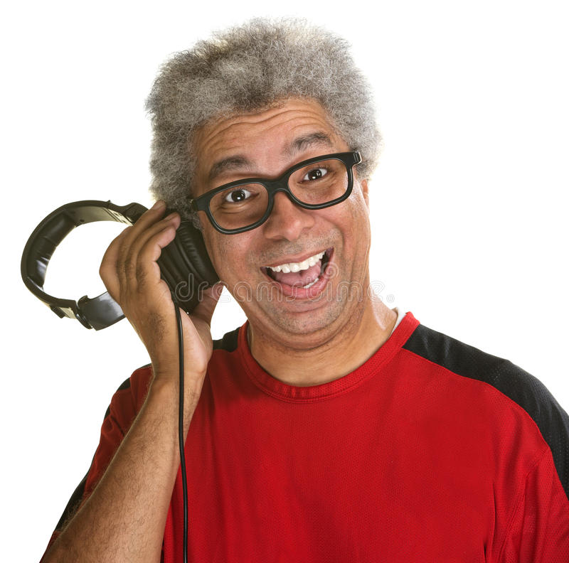 Excited Disc Jockey. Holding headphones to his head stock photos