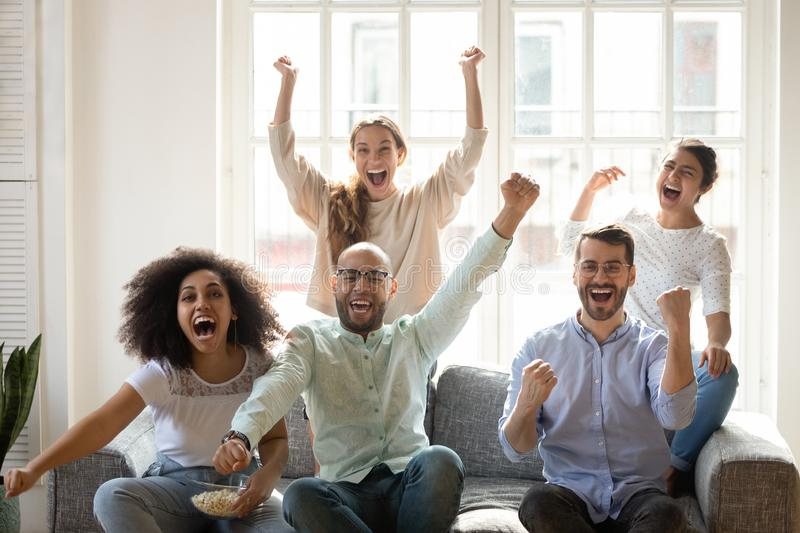 Excited diverse friends celebrating successful football match result royalty free stock photos