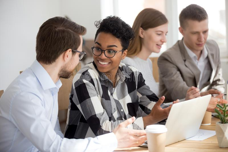 Excited diverse people talk at casual office meeting stock photos