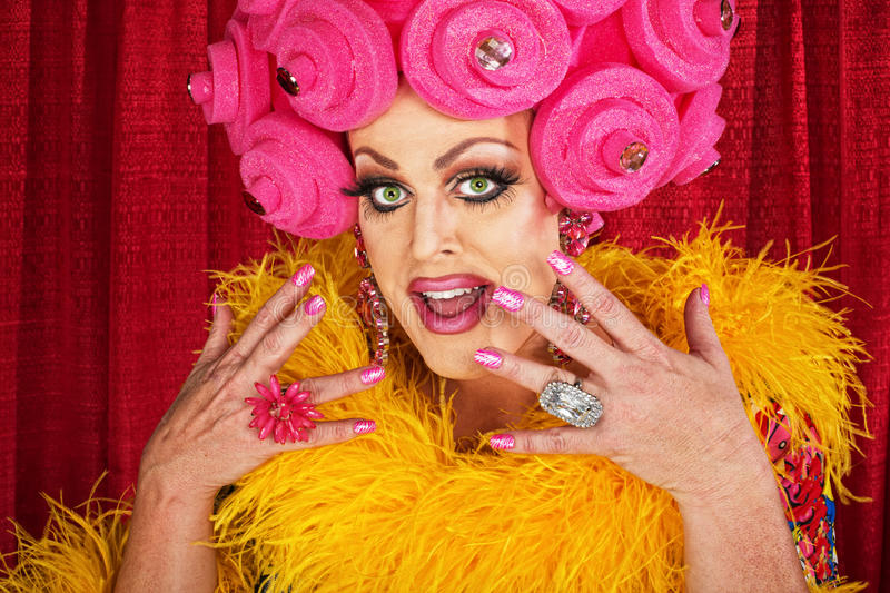 Excited Drag Queen. Excited white male drag queen in yellow boa royalty free stock images