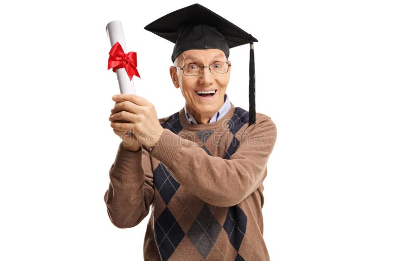 Excited elderly man with a degree and a graduation hat stock photo